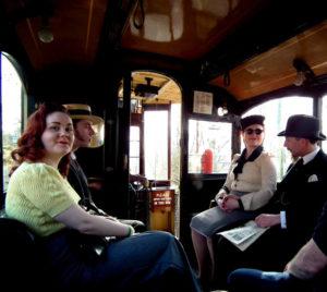 People on tram - 40s dress